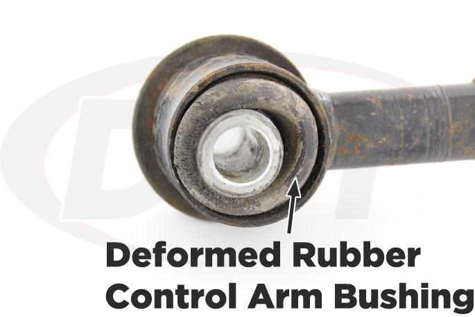 degraded rubber control arm bushing